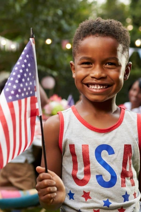 Boy holding an American flag representing a Chattanooga 4th of July Event