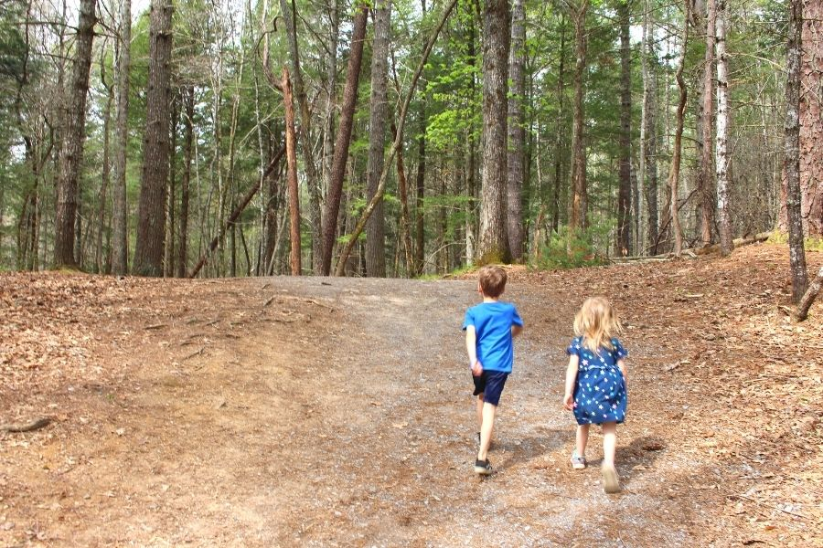 Cades Cove Activities: Children hiking on dirt trail in Cades Cove
